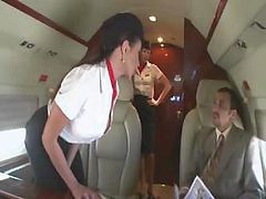 Beautiful Stewardess Is Fucking With Two Businessmen On The Board Of A Plane