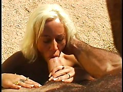 Hot blonde sucking a big hard cock on the beach