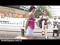 Tied up brunette exposed in public in Europen city