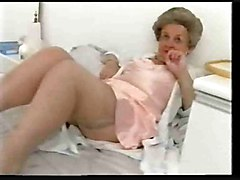 Chubby old granny teases in satin lingerie
