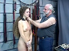 bound and gagged young brunette is restrained, whipped, and spanked