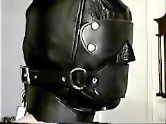 properly kept = in leather hood and armbinder