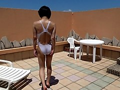 crossdresser in white swimsuit