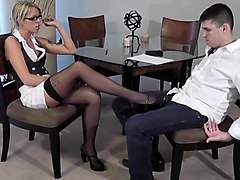 Slut in glasses gives a footjob