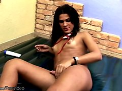Black hair feminine tranny is playing with her puffy nipples