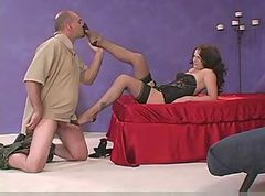 Brunette giving Nylon Footjob