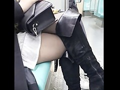 sexy in shiny black pantyhose and long thigh boots