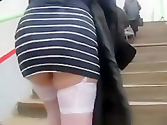 White stockings and black boots upskirted