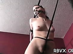 young honey enjoys being torned and thonged for the camera