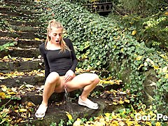 sporty and young white girl outdoors pisses on the stairs