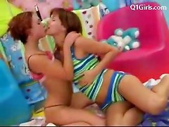 2 Cute Girls In Colorful Clothes Kissing Licking Fucking Each Others Pussies Using Toys In The Girls Room On The Bed