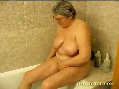 Hot Granny With Toy In Bathroom