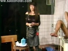 Mistress In Latex Suit Puts Dildo In The Ass Of Slave He Also Has Needles Trough His Nipples