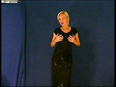 Sexy Blonde Stripping From Shiny Dress